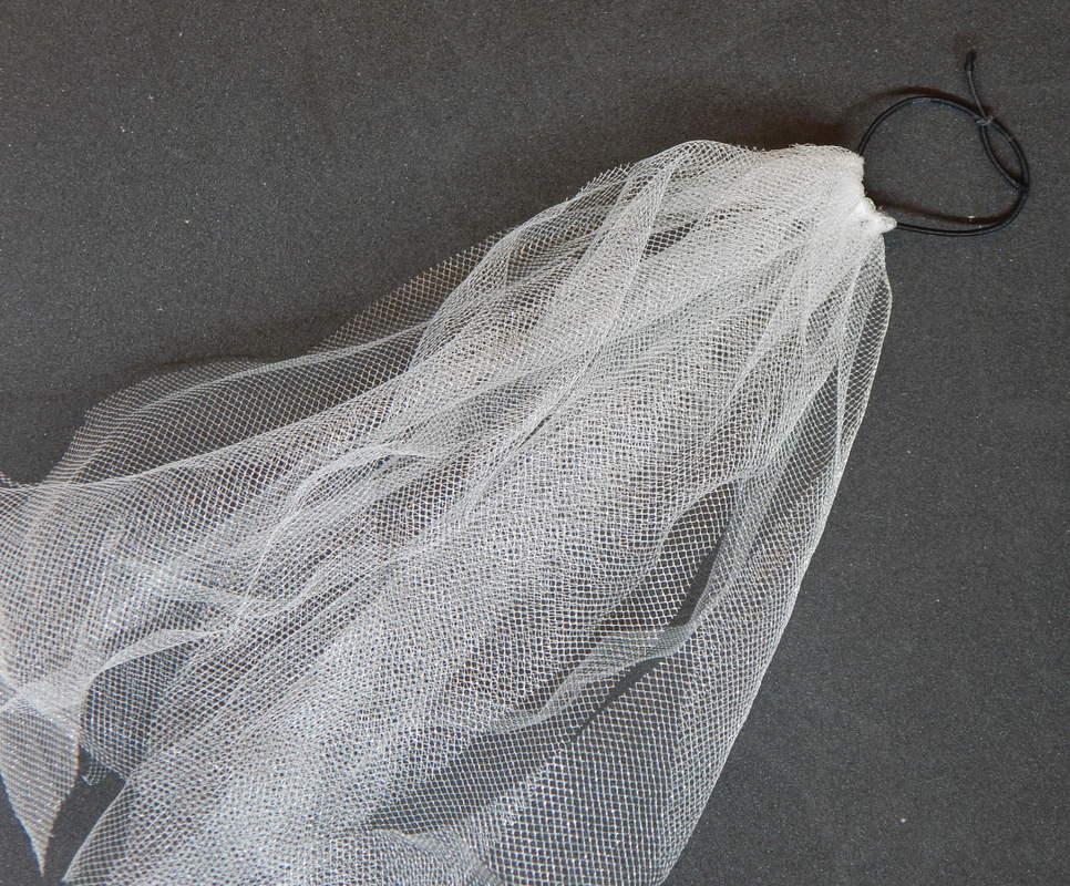 Multiple pieces of tulle attached to a black elastic band